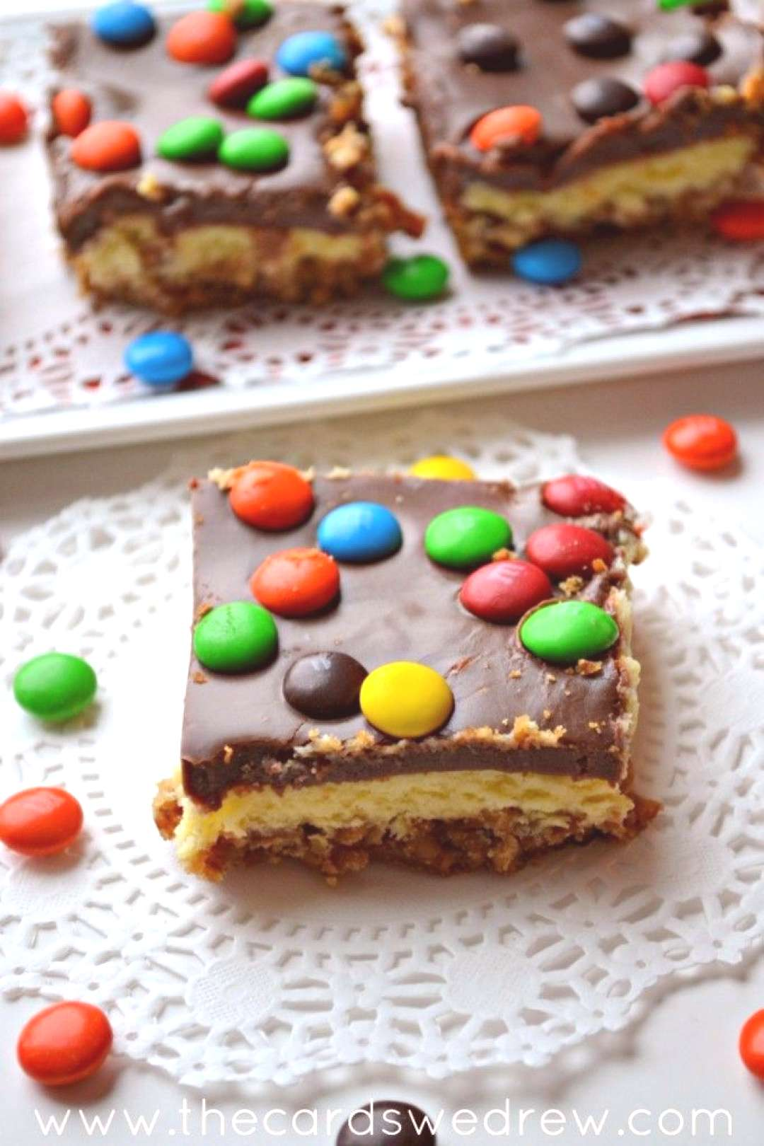 This easy MampM Cheesecake Bar recipe has delicious Pretzel Crust and Chocolate Icing...an easy desse